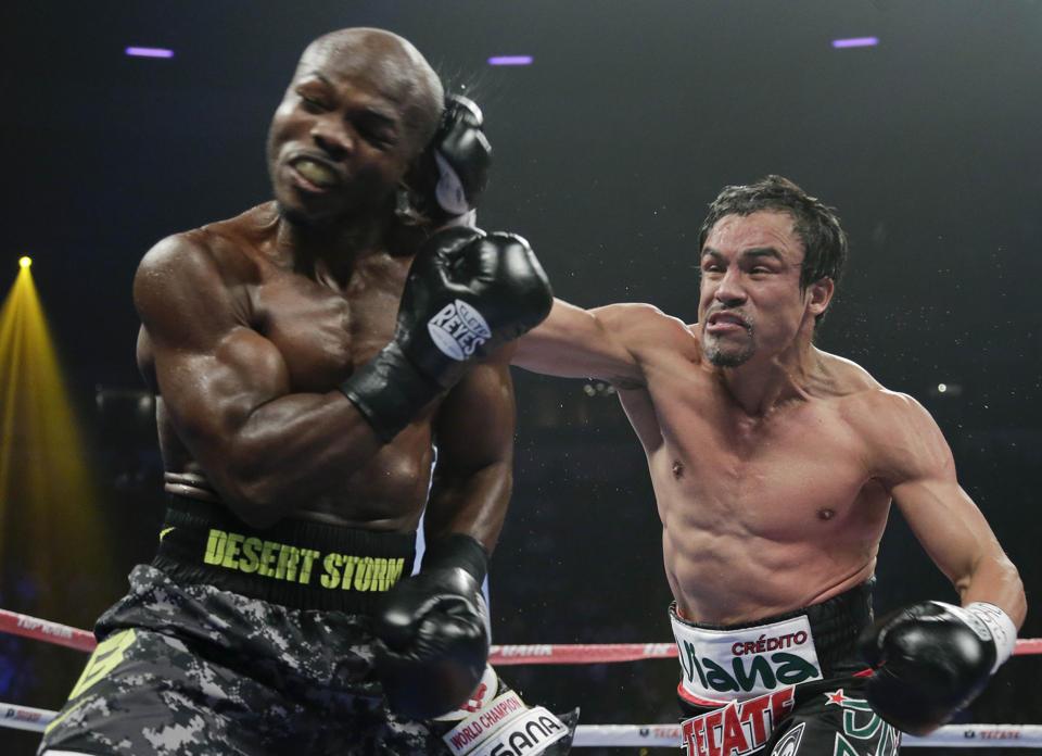 Juan Manuel Marquez hits Tim Bradley
