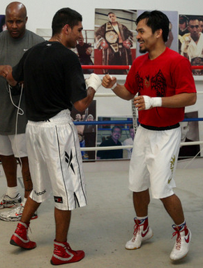 Amir Khan sharing a laugh with Manny Pacquiao